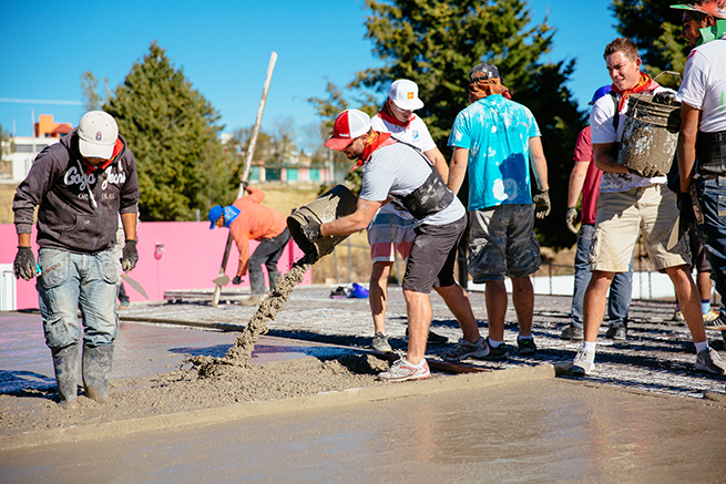 Vivint Gives Back pouring cement